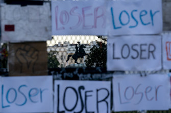 Telling it like it is: Signs on a fence in front of the White House after the November 3 election.