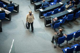 Angela Merkel departs the Bundestag in Berlin.