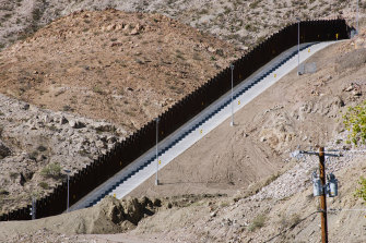 A section of a crowdfunded US-Mexico border wall in Sunland Park, New Mexico. We Build the Wall raised $US25 million to build its own private barrier, but was issued with a temporary restraining order by South Texas State District Judge Keno Vasquez in October.