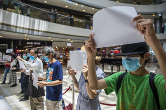 Banned from using pro-democracy slogans, Hong Kong protesters are using blank paper to symbolise censorship.