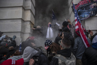 Demonstrators attempt to breach the US Capitol building in Washington on Wednesday.