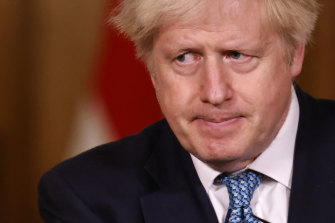British PM Boris Johnson speaks to the press in Britain where the COVID numbers have soared.
