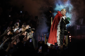 Fury entered the ring dressed as a king on a throne .