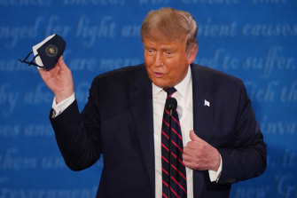 US President Donald Trump holds a mask during the first presidential debate.