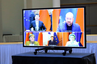 Clockwise from top left: Chinese President Xi Jinping, European Council President Charles Michel, European Commission President Ursula von der Leyen, French President Emmanuel Macron and German Chancellor Angela Merkel during their conference call on Wednesday to finalise a new EU-China investment accord.