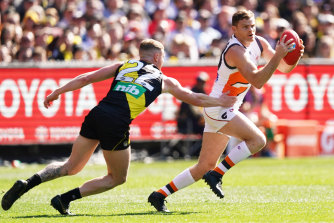 Heath Shaw (right) was a stand-out for the Giants in the AFL grand final.