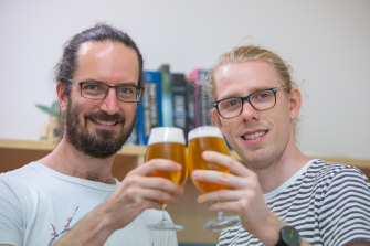 UQ Associate Professor Ben Schulz (left) with PhD researcherEd Kerr and some experimental material.