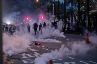Riot police deploy tear gas during a protest in the Wan Chai district of Hong Kong on Sunday night.