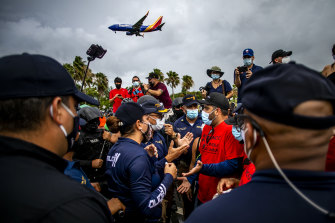 Fearing infection, demonstrators at Luis Munoz Airport in San Juan, Puerto Rico on Saturday protest against the arrival of tourists from the US mainland.
