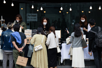 COVID-19 style: people wearing protective masks look at accessories in the Gangnam district of Seoul.