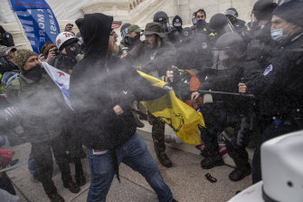 Pepper spray is used as demonstrators battle with US Capitol police officers while breaching the Capitol building grounds in Washington, on Wednesday.