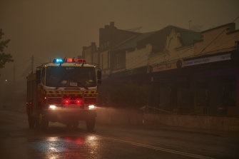 An RFS truck travels through Bundanoon as rain begins to fall this month.