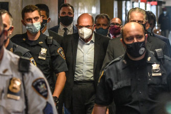 AllenWeisselberg, chief financial officer of Trump Organisation, centre, walks towards a courtroom in New York.