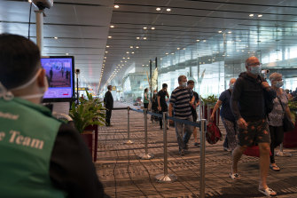 Passengers are screened on arrival at Singapore's Changi Airport.