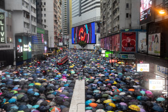 Tens of thousands of demonstrators march during a protest in the Causeway Bay district of Hong Kong, China, on Sunday.