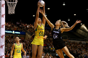 Australia's Caitlin Bassett and the Silver Ferns' Jane Watson have eyes only for the ball during the hard-fought clash. Bassett later left the court and was replaced by Caitlin Thwaites.