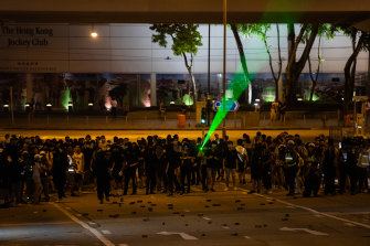 Protests raged outside the stadium that housed Carrie Lam's community dialogue event.