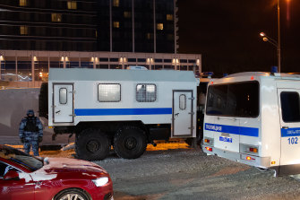 Polices buses await the arrival of Navalny at Vnukovo International airport in Moscow.