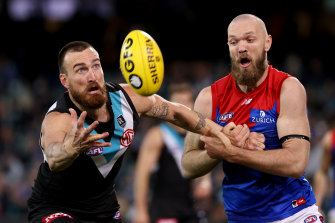 Port Adelaide's Charlie Dixon and Demon Max Gawn go head-to-head in Thursday night's clash.