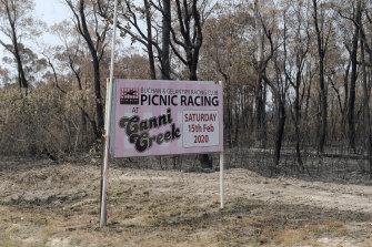A sign lets locals know the race meeting will go ahead next month.