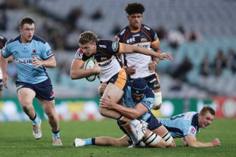 Bayley Kuenzle is tackled at ANZ Stadium.