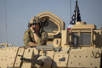 A US soldier looks out of a tank at an American base at undisclosed location in north-eastern Syria.