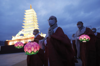 Buddhist monks march around a lantern tower in the shape of a Buddhist temple to celebrate Buddha's birthday at the Gwanghwamun Plaza in Seoul, South Korea on Thursday.