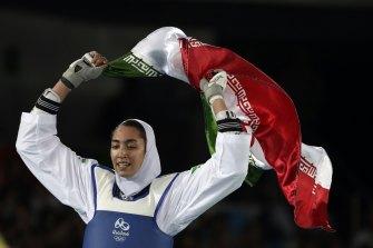 Iranian athlete Kimia Alizadeh celebrates winning bronze in taekwondo at the 2016 Olympics in Rio de Janeiro.