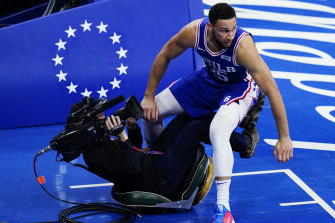 The 76ers' Ben Simmons collides with a cameraman during Philadelphia's game five win over the Wizards.