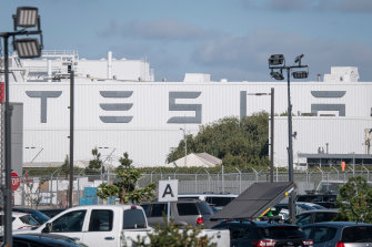 The electric carmaker was accused of turning a blind eye to racial taunts and offensive graffiti the man endured at its auto plant in Fremont, California.