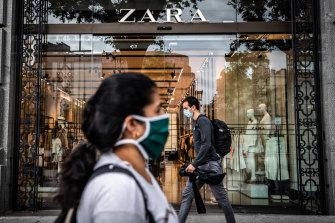 Pedestrians wear protective face masks in Barcelona, Spain.
