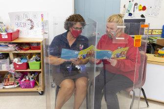 Teachers demonstrate a plexiglass reading corner in a classroom at John B. Wright Elementary School in Tucson, Arizona.