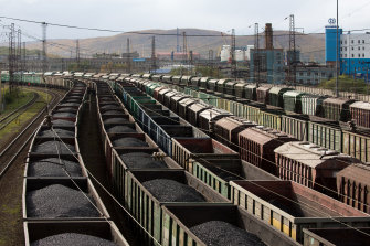 Freight wagons, many filled with coal, line the railway tracks at Russia's Murmansk station.