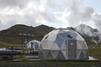 Pods, operated by Carbfix, containing technology for storing carbon dioxide underground, in Hellisheidi, Iceland. Startups Climeworks and Carbfix are working together to store carbon dioxide removed from the air deep underground.