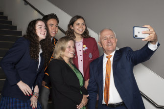 Malcolm Turnbull and his daughter Daisy Turnbull Brown with students Alice Morgan, Ethan Cheung and Eloise Aiken at Sydney University on Friday.