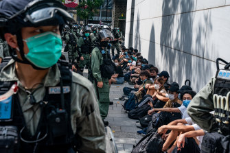 Riot police detain pro-democracy protesters during a rally in Hong Kong's Causeway Bay district on Wednesday.
