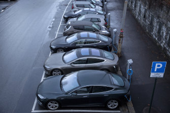 Electric vehicles charge at a station in Oslo.