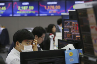 A currency trader watches monitors at the foreign exchange dealing room of a bank in Seoul, South Korea.