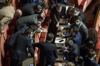 Matteo Salvini, League leader, right in blue, speaks with senators after the confidence vote.