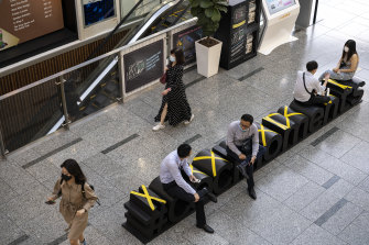 Seats inside a shopping mall in Singapore are marked to prevent people sitting too close to each other.