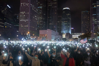 Demonstrators light the night with their smartphones in support of the Spark Alliance at Edinburgh Place, Hong Kong, on Monday.