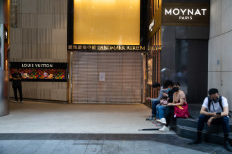 Shops in Hong Kong's once-vibrant commercial districts are now shuttered to prevent damage.