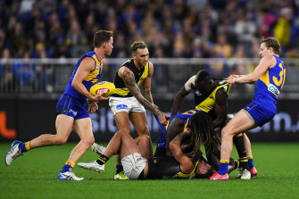 West Coast and Richmond players scrap during the third term.