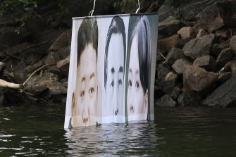 A banner attached to a balloon with images of North Korean leader Kim Jong-un, the late leader Kim Il-sung, and Kim Yo-jong, released by Fighters For Free North Korea in Hongcheon, South Korea, on Tuesday. The North has repeatedly warned it would retaliate against leaflets and other information being distributed over the border.