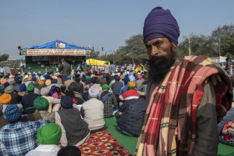 A man participates in a farmers protest in Singhu, bordering Delhi, India. Farmers are demanding the repeal of efforts to liberalide the agriculture market.