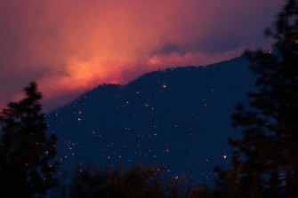 A wildfire burns above the Fraser River Valley near Lytton, British Columbia, Canada, on Friday, July 2, 2021.