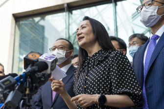 """""""Over the last three years my life has been turned upside down"""": Meng Wanzhou reads a statement  outside the court in Vancouver."""