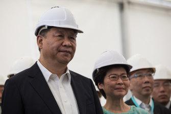 Xi Jinping and Carrie Lam visit a section of the Hong Kong-Zhuhai-Macau bridge in Hong Kong on July 1, 2017.