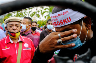 A supporter of former Malaysia prime minister Najib Razak reacts outside on Tuesday.
