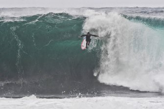 "Massive waves pose a significant challenge for all surfers off ""Deadmans"" near Manly Beach on Wednesday."